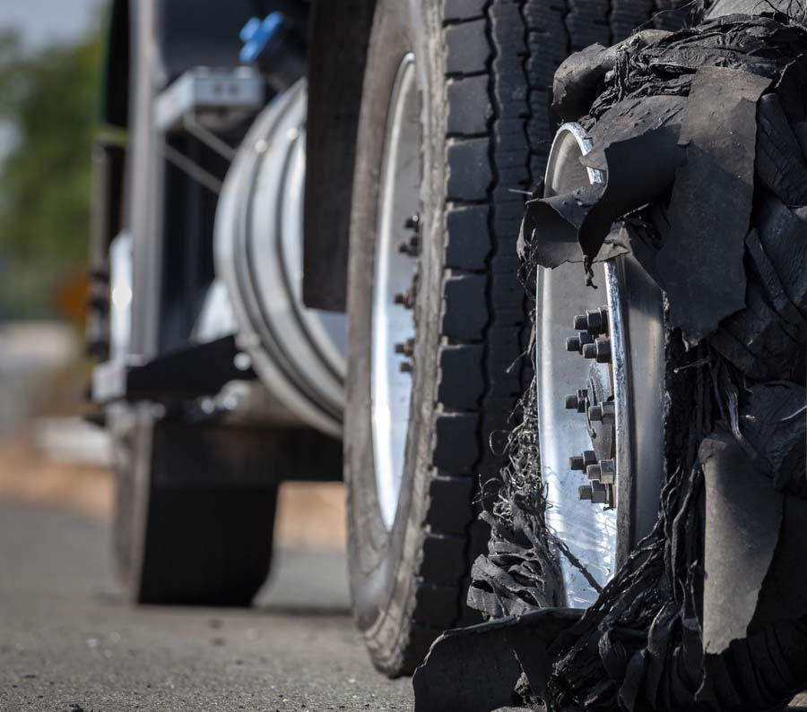 Detailed image of a tire blowout of a truck.